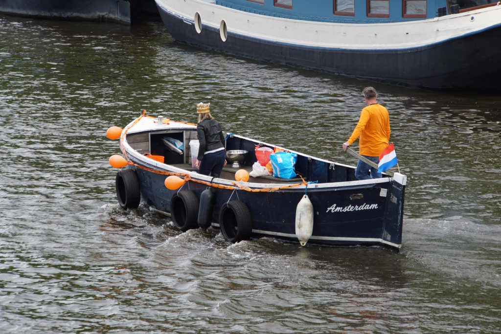 Kingsday in Amsterdam by boat